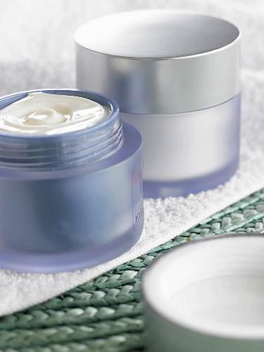Pots of skin cream in bathroom