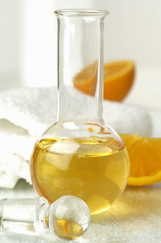 Orange oil, towels in background