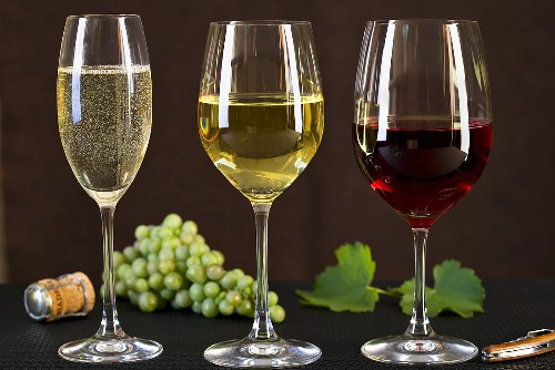 A glass of champagne, a glass of white wine and a glass of red wine