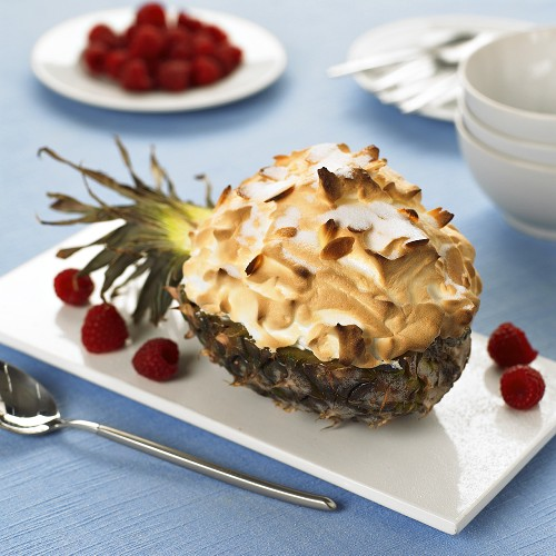Vanilla ice cream & fruit under baked meringue in pineapple