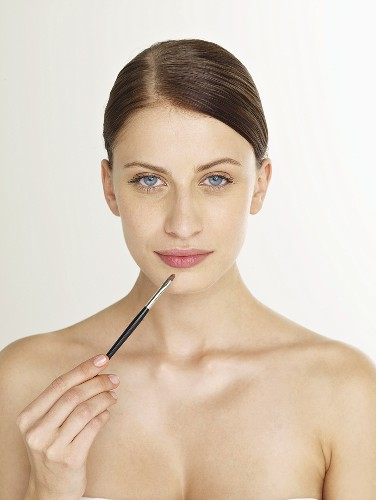 Woman with a lip brush