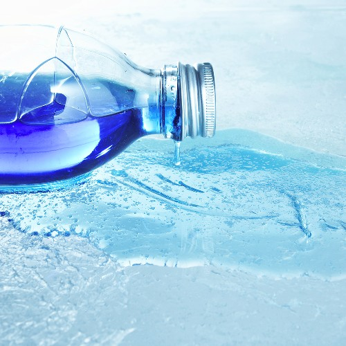 Blue bath product in a bottle