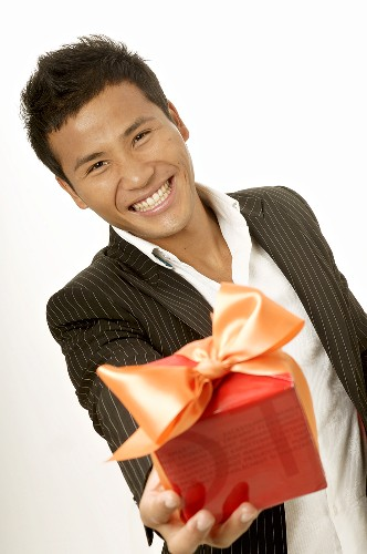 Asian man with gift