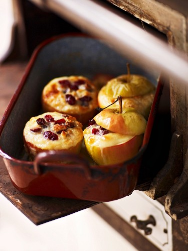 Baked apples filled with white chocolate and cranberries