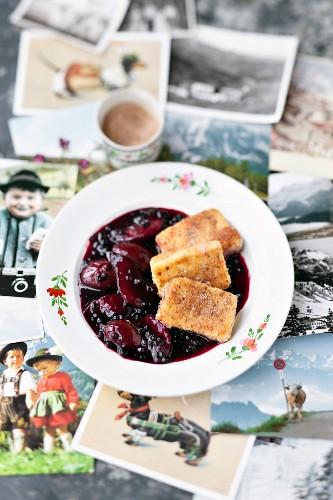 Hollerkoch (stewed elderberries and damsons) with semolina slices (Austria)