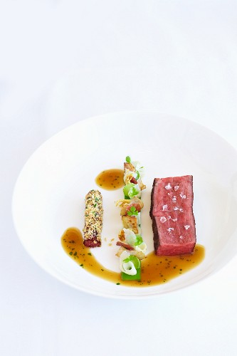 Angus beef fillet with beef tea, artichokes and parsley jelly