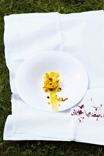 A dessert made with mascarpone cream, mango, Ketjap Manis (sweet soy sauce) and plum syrup