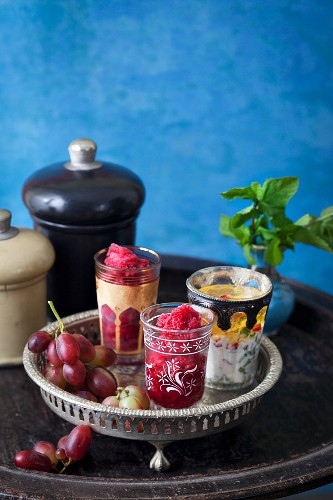 Pomegranate sorbet in oriental glasses on a tray
