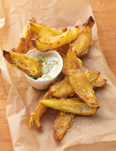 Baked potato wedge with cheese and a dip