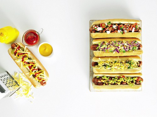 Five hot dogs with assorted toppings