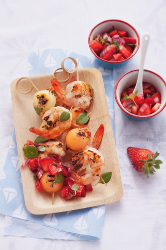 Langoustine skewers with melon and strawberry salsa