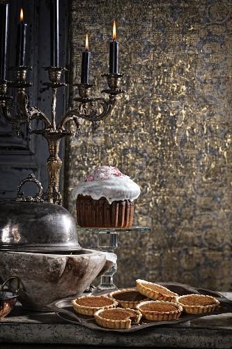 Treacle tarts and an iced sponge cake