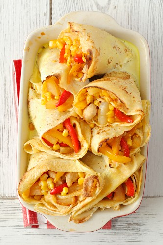 Pancakes filled with chicken, peppers and pineapple, in garlic sauce
