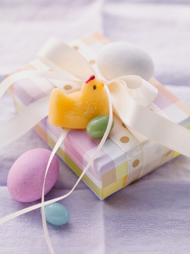 An Easter parcel with a fondant chick and Easter eggs