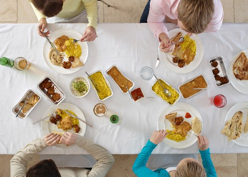 People eating Indian dishes (view from above)