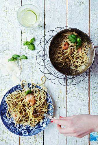 Spaghetti with green pesto, prawns, basil and parmesan