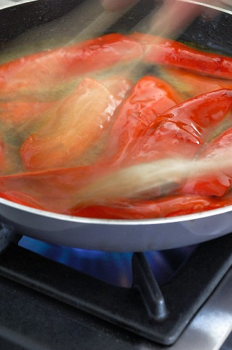 Peppers frying in oil