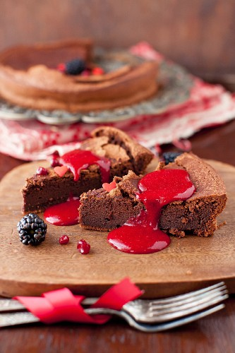 Slices of French Chocolate Cake Topped with Berry Coulis