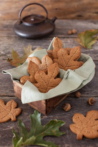 Leaf Shaped Whole Wheat Maple Graham Cookies in a Box and on a Table; Acorns