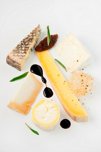 A cheese plate with fig chutney, honeycomb and balsamic vinegar