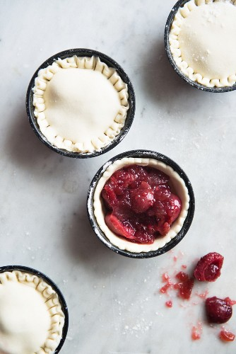 Mini almond pies with cherry filling being made (view from above)