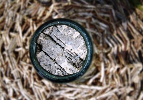 A cork in a wicker bottle