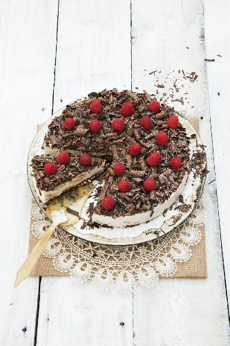 Chocolate cheesecake with raspberry decoration