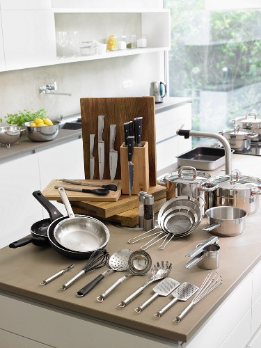 Assorted pots and pan and cooking utensils in a kitchen
