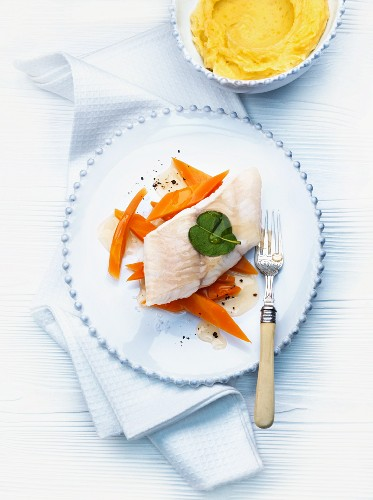 Steamed fillet of wels catfish on a bed of carrots with honeydew honey