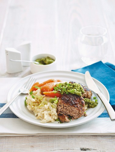 Lamb burgers with colcannon, baby carrots and a basil sauce