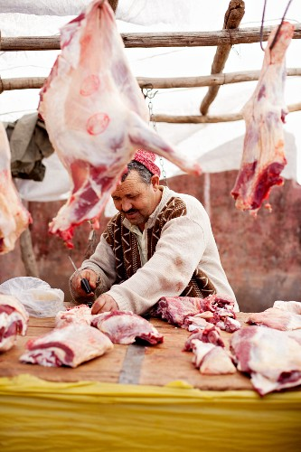 A butcher jointing meat at the market (North Africa)
