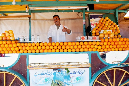 A North African man selling freshly squeezed orange juice