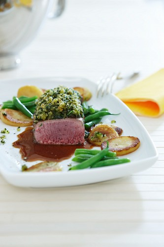Saddle of lamb with beans and fried potatoes