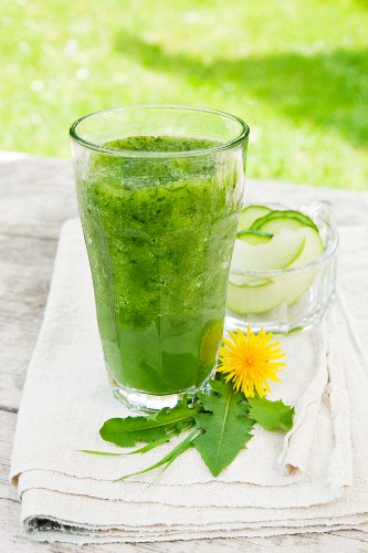 A green smoothie made from Granny Smith apples, cucumber, barley grass, dandelion leaves and young stinging nettles