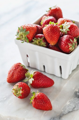Fresh strawberries in a porcelain basket