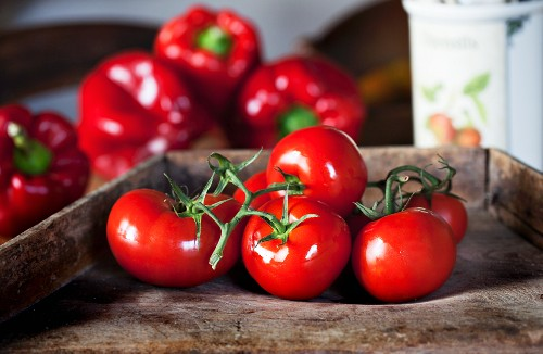 Bright red tomatoes and red peppers