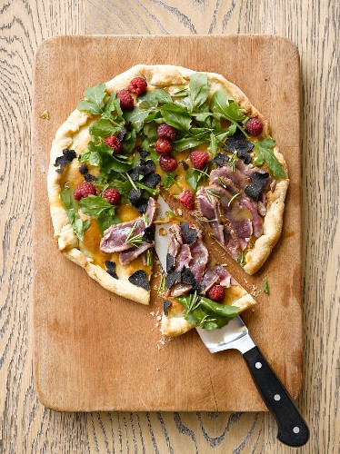 A raspberry, truffle, wild boar and rosemary pizza