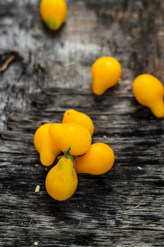Yellow tomatoes on an old table