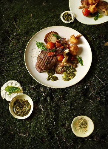 Fillet steak with oyster mushrooms, vegetables and basil sauce