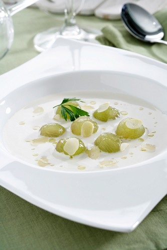 Ajoblanco (cold garlic and almond soup, Spain) garnished with grapes