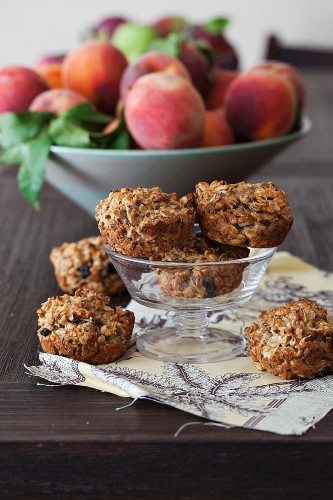 Small oat breakfast cakes with seeds, cashew nuts & dried berries and apples