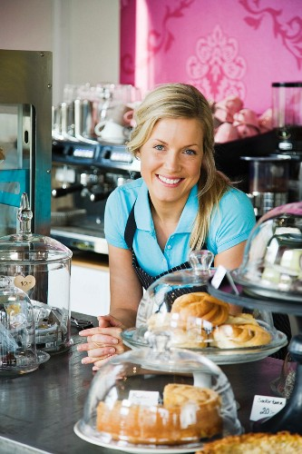 A woman working at a cafe, Sweden.