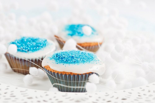 Christmas cupcakes decorated with blue sugar