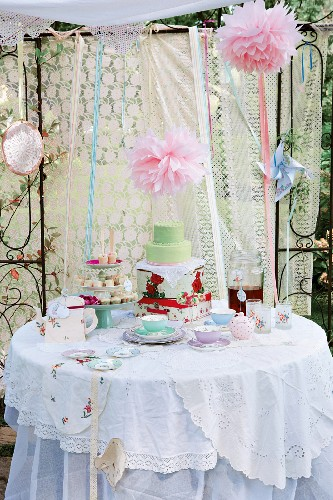 A vintage children's birthday party with tea, cake and biscuits