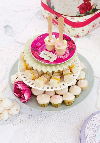 A vintage children's birthday party in a garden with mini cupcakes