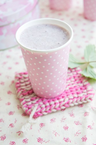 Strawberry and banana milk in a polka-dot cup