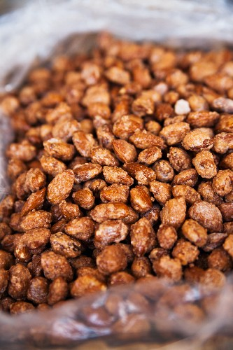 Caramelised almonds in a plastic bag (close-up)