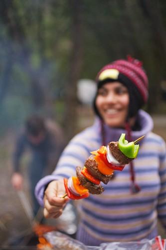 A Woman Holding a Kabob