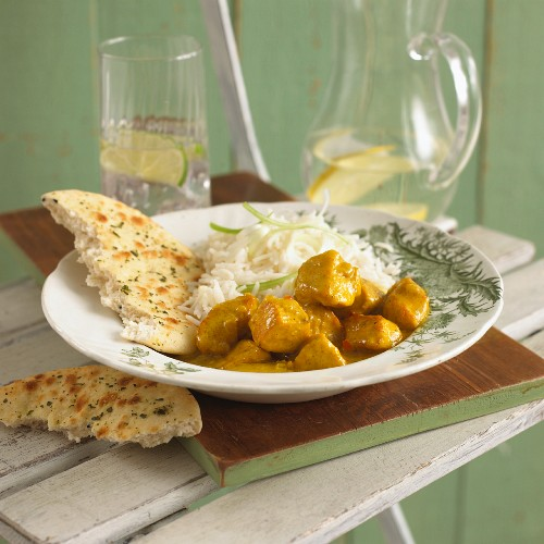 Indian Butter Chicken Curry with Rice and Naan