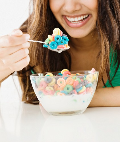 Close up of Middle Eastern woman eating cereal